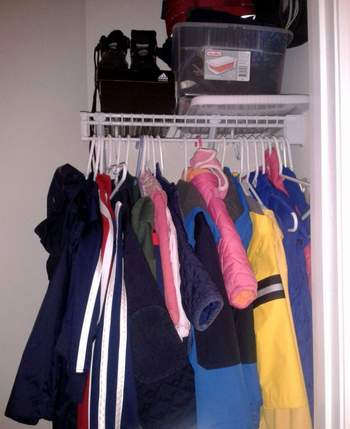 08  mudroom in a closet top shelf and coats