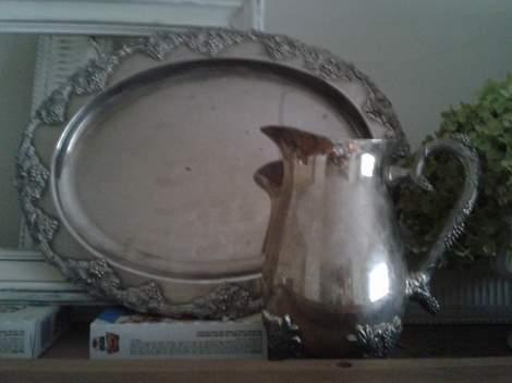 05 top of china cabinet frames silver tray and jug