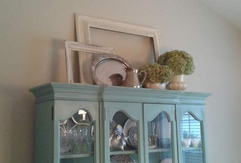 06 top of china cabinet from foyer'