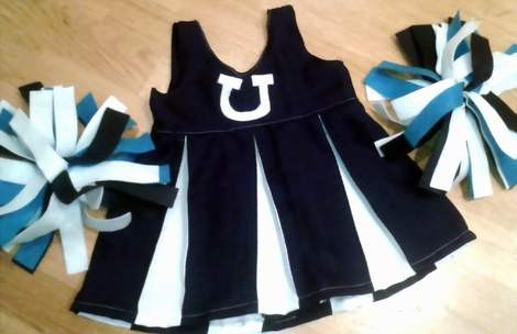 DIY navy and white cheer uniform with pom poms